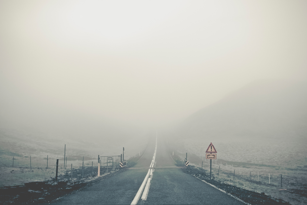 Iceland-travel-guide-foggy-road-mystical
