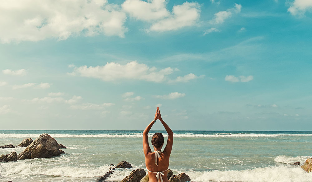 reversing-adrenal-fatigue-and-stress-woman-yoga-beach